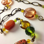 Green orange and bronze beaded necklace - long Y shape