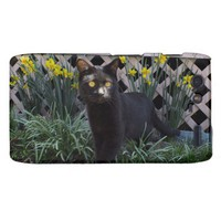 Black Cat In The Daffodils Droid RAZR Case from Zazzle.com