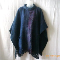 Large blue wool poncho with roll neck, fringe and front pocket