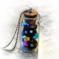 Soot sprites in a bottle necklace