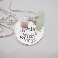 Positive energy hand stamped silver necklace with opaque green czech glass beads and feshwater pearl