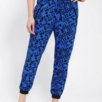 Urban Outfitters - Sparkle &amp; Fade Faux Leather-Trim Printed Pant