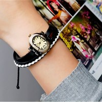 Vintage Style Bronze Alloy & Leather Women Bracelet Quartz Watch (White & Black)