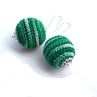 Green crochet sphere earrings dangle on silver plated hooks