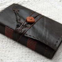 Terracotta Tales Dark Brown Reclaimed Leather by bibliographica