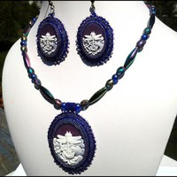 White Dragonfly and Lotus Against Purple Sky Bead Necklace Earring Set