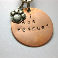 I was rescued hand stamped pet tag and paw print charm | RockBug - Pets on ArtFire