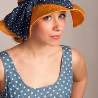 Orange Floppy Sun Hat with Blue and White Bow
