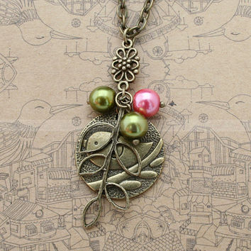 Antique bronze necklace with bird pendant leaves by luckyvicky