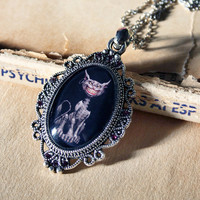 Madness returns Alice in Wonderland - Cheshire cat cabochon covered pendant