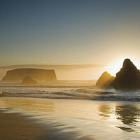 Sunset Behind Offshore Rocks Bandon Photograph by Philippe Widling - Sunset Behind Offshore Rocks Bandon Fine Art Prints and Posters for Sale