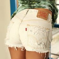 NEWYORK destroyed white levis high waisted cut offs by Deadenim