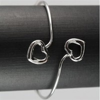 Silver bangle bracelet with hearts
