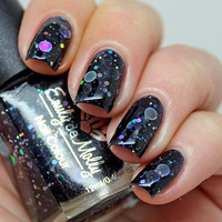 "Nail polish - ""Dark Forces"" holographic silver dot glitter in a black base"
