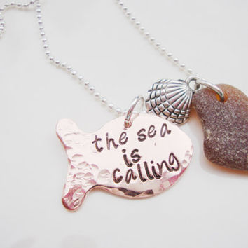 The sea is calling copper hand stamped fish necklace with shell charm and sea glass