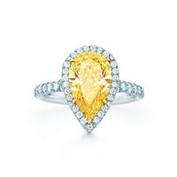 Tiffany & Co. -  Pear-shaped Fancy Intense Yellow diamond ring in platinum with white diamonds.