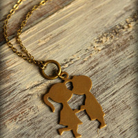 Girl Kisses Boy Necklace in Aged Brass by saffronandsaege on Etsy