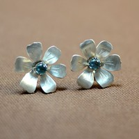 Elegant flower earrings in sterling silver with blue topaz