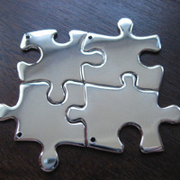 Four Silver Puzzle Piece Pendant Necklaces by GorjessJewellery