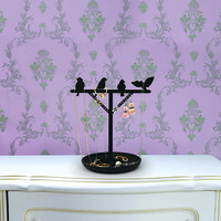 Kikkerland Design Inc   » Products  » Jewelry Stand + Bird