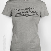 Never judge a book by its movie - humor funny librarian loves to read chapter watch geeky nerdy bookworm text tshirt t-shirt tee shirt