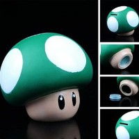 "Super Mario Brothers 3"" Mini Green Mushroom Plastic Coin Piggy Bank: Toys & Games"