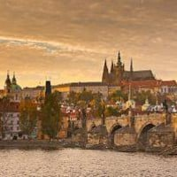 Charles Bridge and Prague Castle at Sunset Prague  by cooperativ