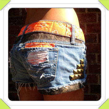 Camo and Orange Studded Cutoff Denim Shorts. Camouflage Hunting