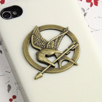 The Hunger Games Logo Mockingjay pendant cream by qizhouhuang