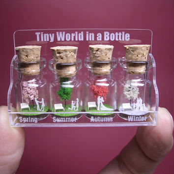 Tiny trees with a couple & family in four by tinyworldinabottle