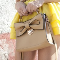 The handbag crafted in PU, featuring bowknot embellished flap fastening to the front with metal buckle detail, grab handle fastening to the top with press snap detail, concealed zipped closure and a long detachable strap. - Fashion Gallery of OASAP.COM