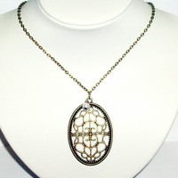 Filigree metal pendant pearl bronze necklace