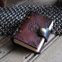Tiny hand bound leather journal