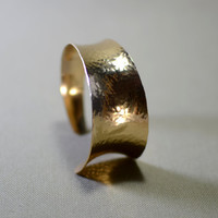 Hammered bronze anticlastic cuff bracelet with asymetrical curve