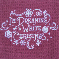 "Christmas kitchen waffle weave dish towel with embroidered ""I'm Dreaming of a White Christmas"" with snow flakes and swirls."