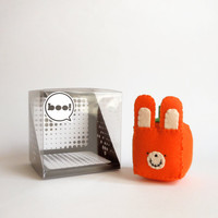 Orange Jack O'Lantern in a cubed bunny shape for Halloween decor