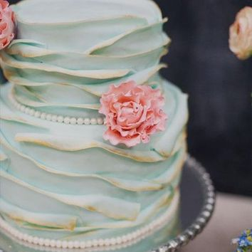 Cute teal wedding cake with pink flower details