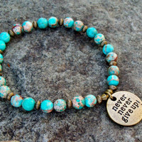 New ~~ Stretch Bracelet in Magnesite Gemstone Turquoise  Blue with Antiqued Brass Charm