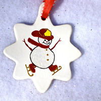 Skating Firefighter Snowman Ornament