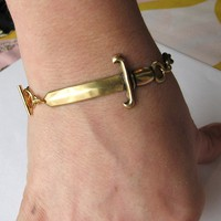 gold sword bracelet by friendlygesture on Etsy