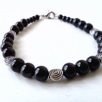 Black pearl and metal spiral beaded bracelet by PinkCupcakeJC