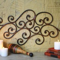 whimsical curving swirling iron wall art