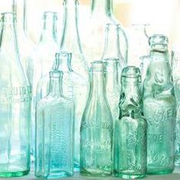antique bottles no 3 sunlight through blue green by leapinggazelle