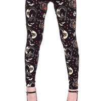 Sourpuss – Playful Winter Lucy Fur Print Leggings In Black/Multi | Thirteen Vintage