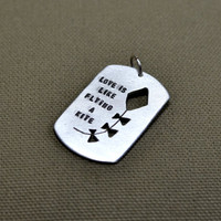 Love is like flying a kite sterling silver pendant