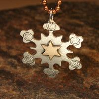 Sterling silver snowflake pendant with a golden bronze star