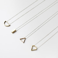 Half circle necklace: geometric jewelry in brass and sterling silver