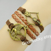 Mockingjay bracelet,Mockingjay pin bracelet,catching fire,Bows,arrows bracelet,Brown,leather braided bracelet,Hunger,hipster jewelry,Games