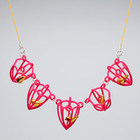 Birds in a cage necklace. 3D printed nylon, silk cord, brass birds, silver findings