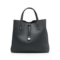 Tiffany & Co. - Reversible tote in smooth leather with detachable strap. More colors available.